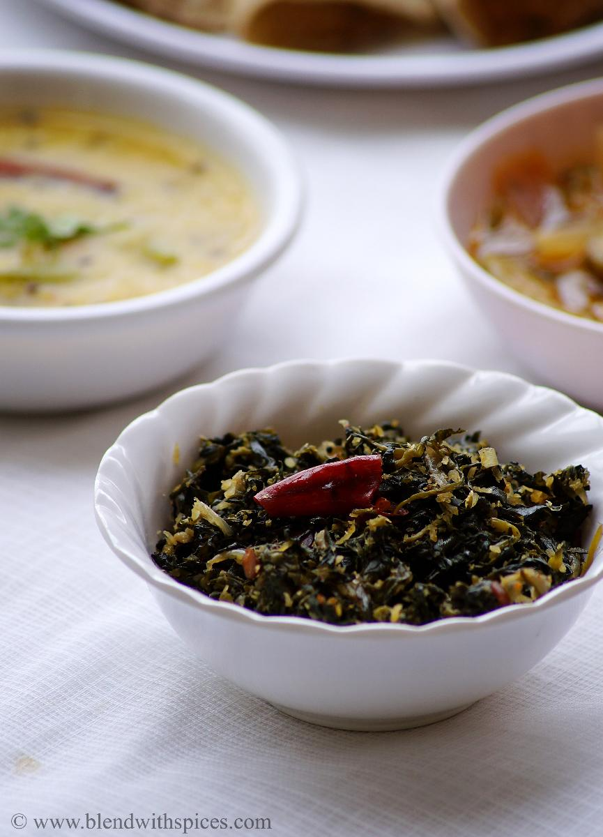 south indian green stir fry served in a white bowl along with lentils