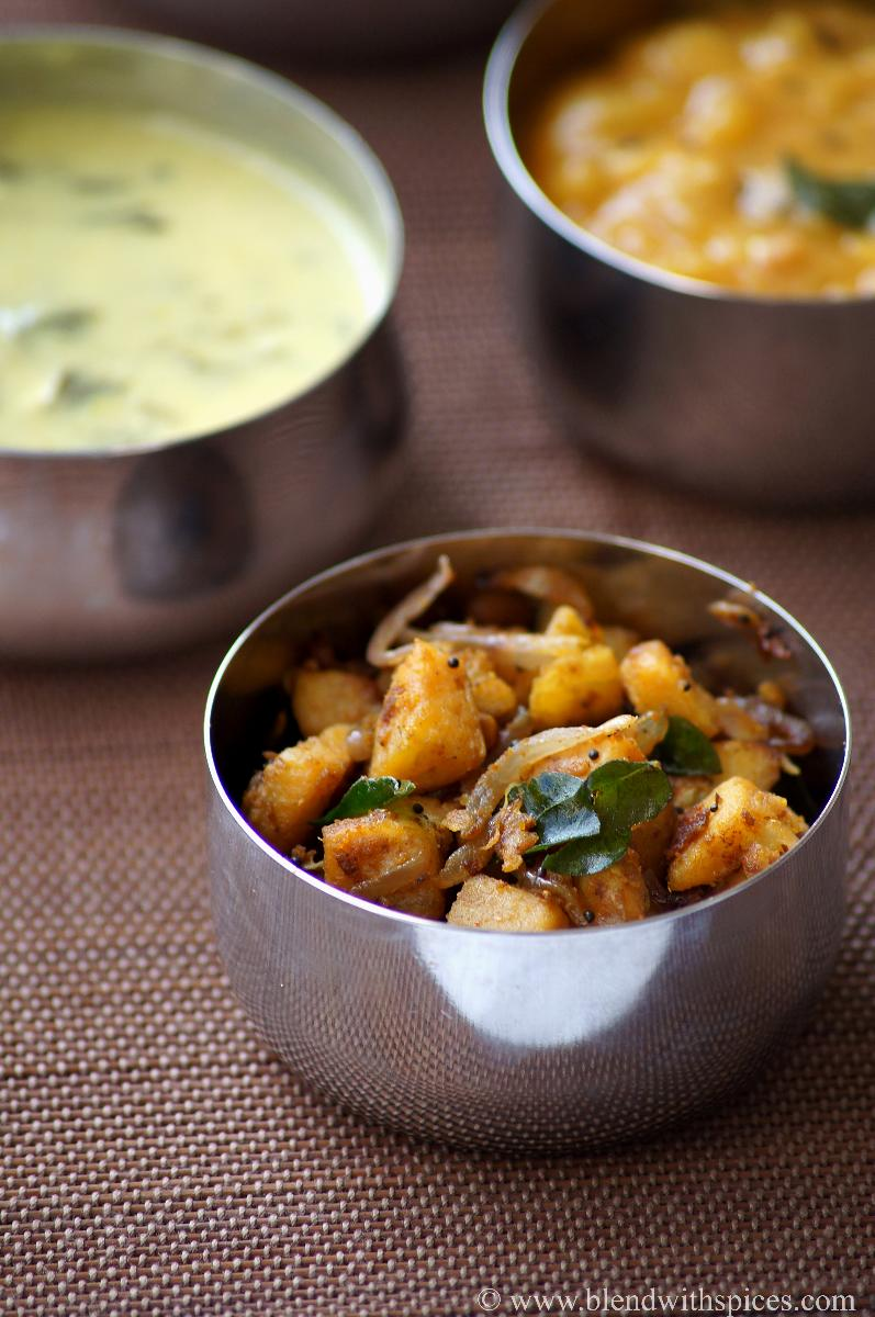 plantain fry with sambar powder served in a steel bowl along with other south indian dishes