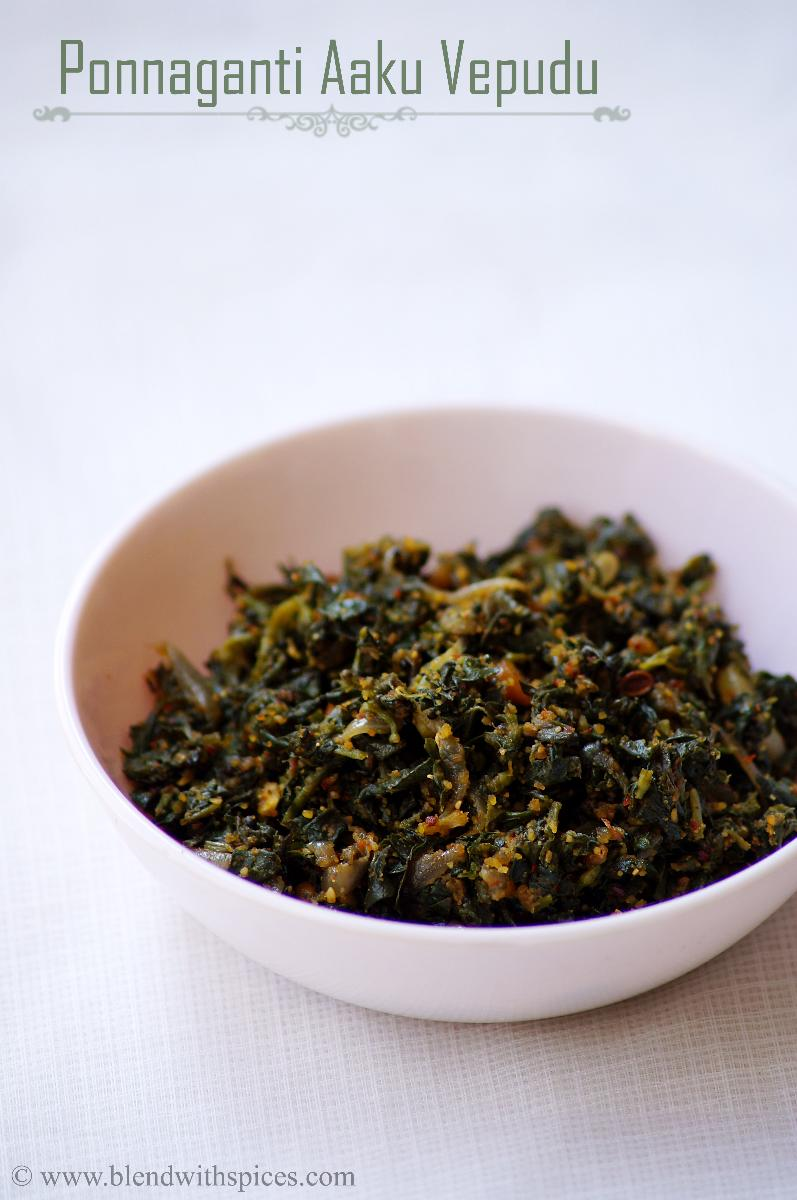 water amaranth leaves stir fry with spices served in a white bowl on a white background