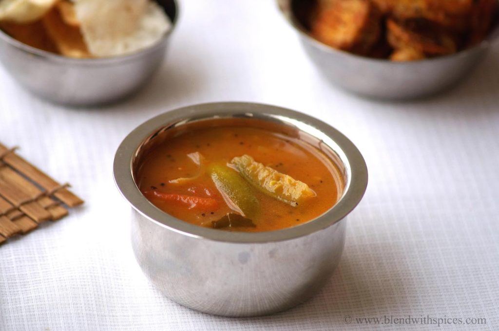 dondakaya pulusu recipe, how to make dondakaya pulusu, ivy gourd in tamarind sauce, andhra pulusu