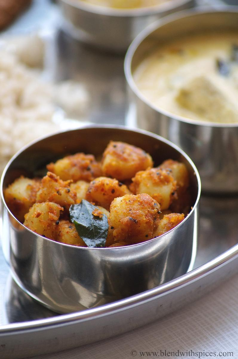 Andhra style sweet potato podi curry served in a steel bowl along with steamed rice