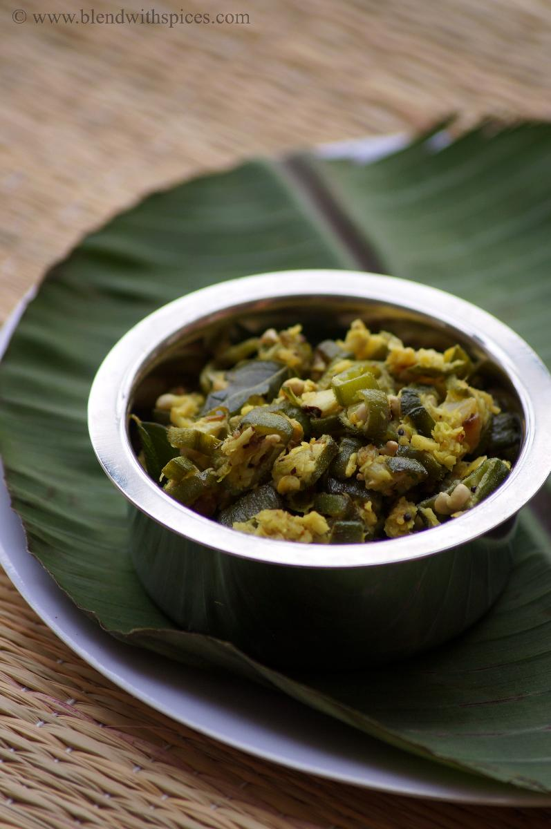 kerala style okra stir fry with coconut served on a banana leaf