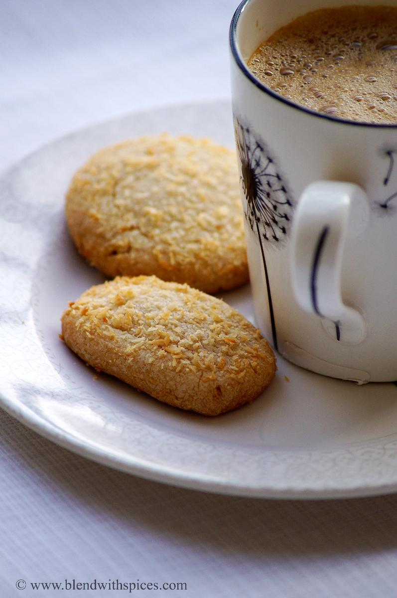 easy coconut cookies recipe, baking eggless cookies, wheat coconut cookies recipe