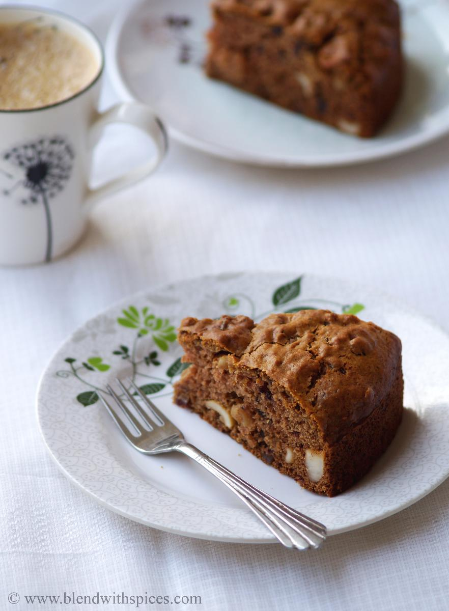 A slice of date cake served with a mug of coffee