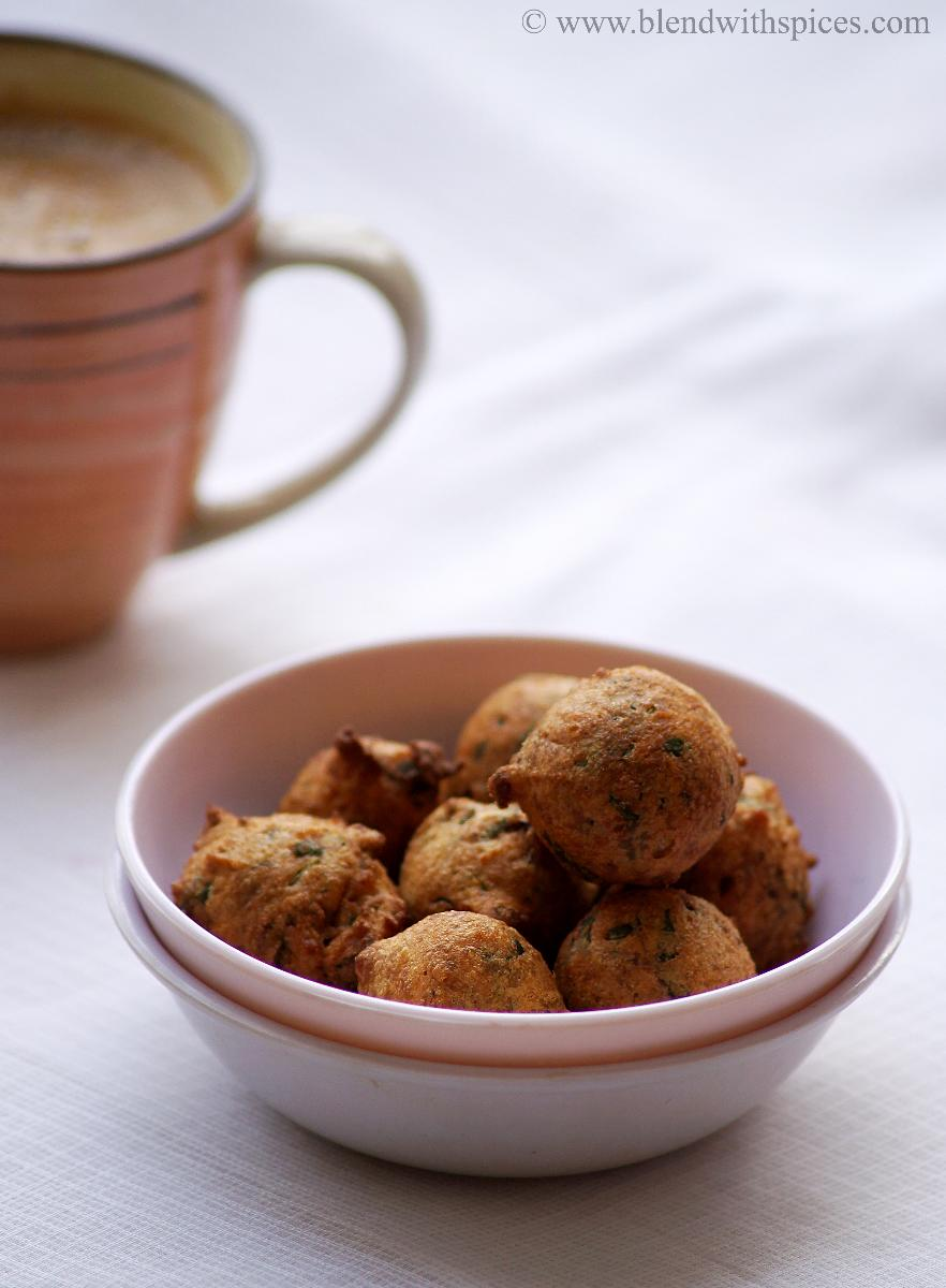 A bowl of methi na gota snack with a cup of coffee