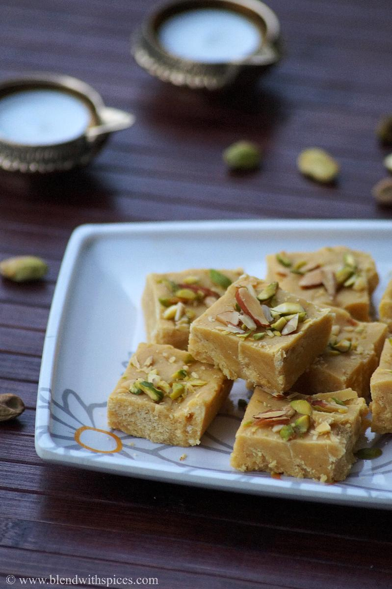 Indian sweet garnished with almonds and pistachios served on a plate