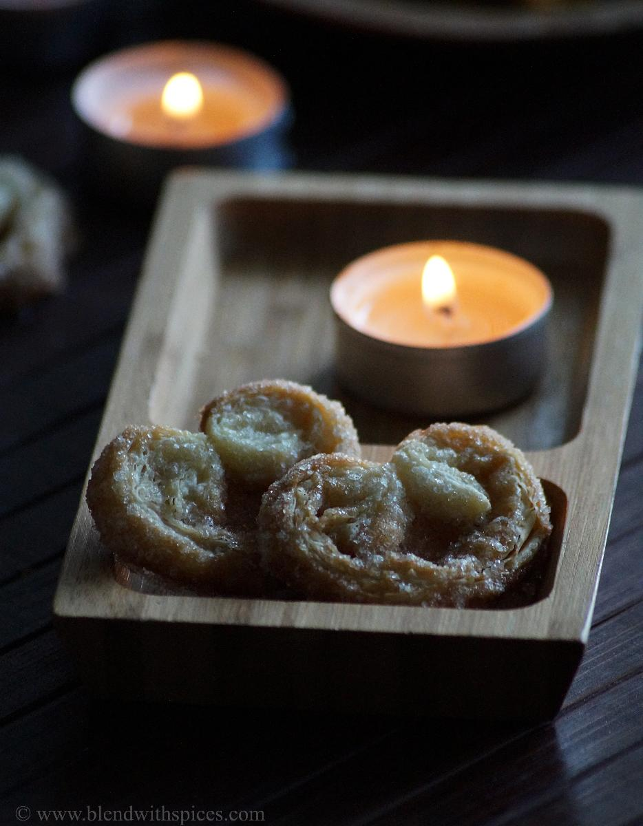 heart shaped fresh palmier cookies served on a wooden plate