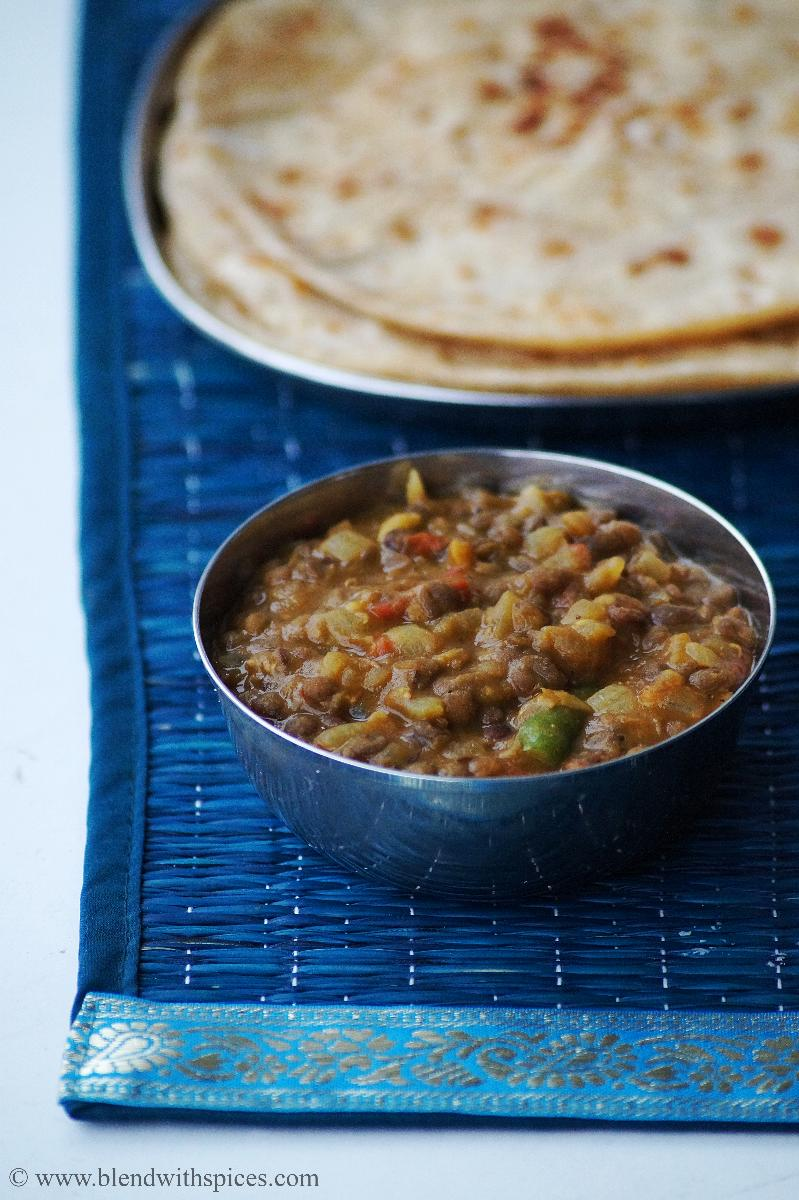 a cup of north Indian style whole masoor dal or brown lentils with some rotis or Indian flatbreads