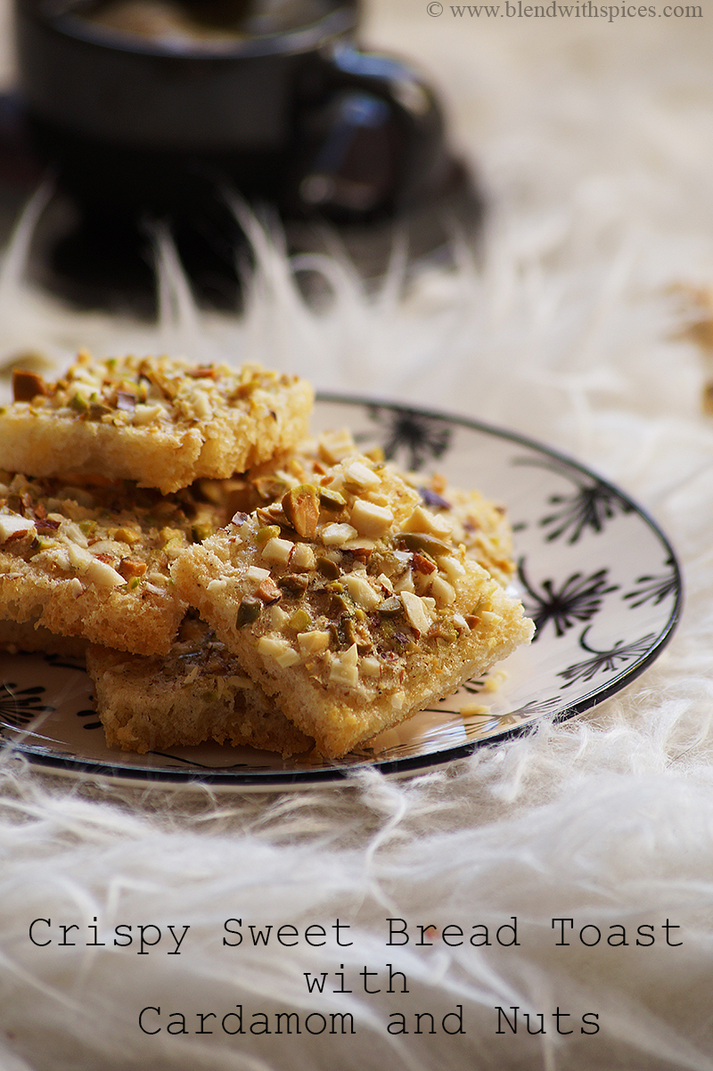 a plateful of crispy sweet bread toast with cardamom and nuts and served with a cup of tea