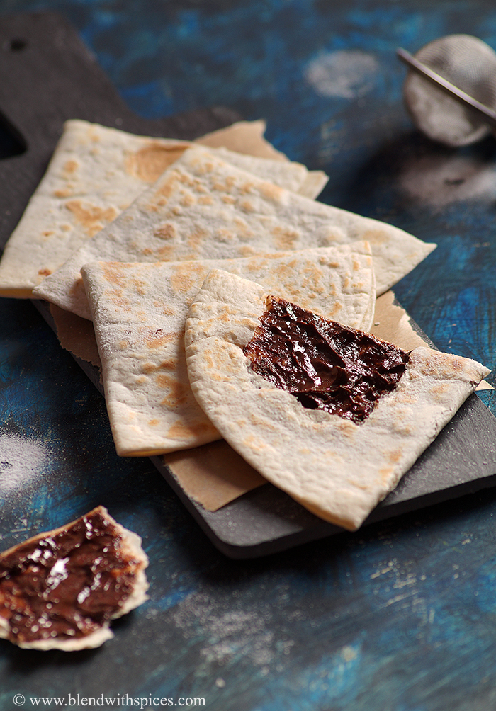 chocolate stuffed wheat tortilla triangles sprinkles with powdered sugar