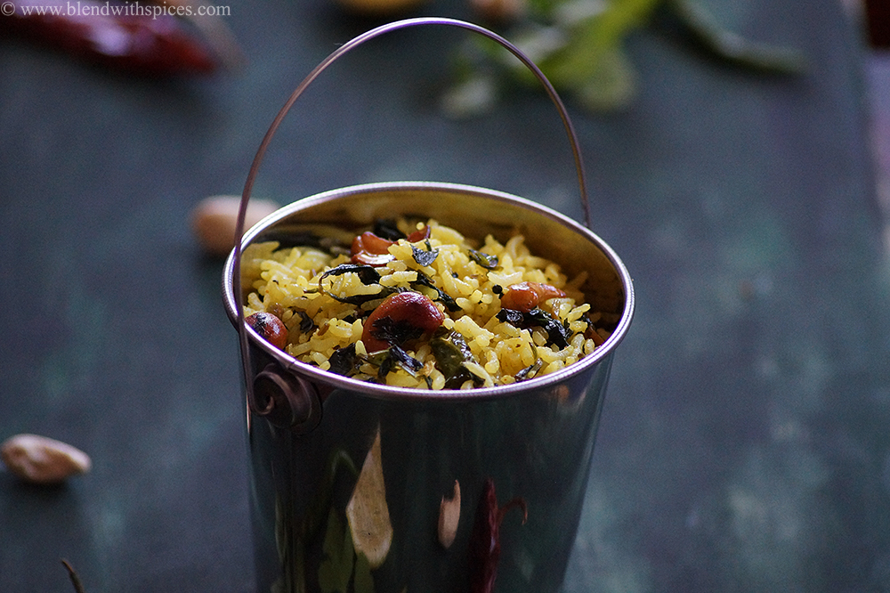 Nimmakaya kothimeera pulihora served in a small bucket and garnished with cashews and peanuts
