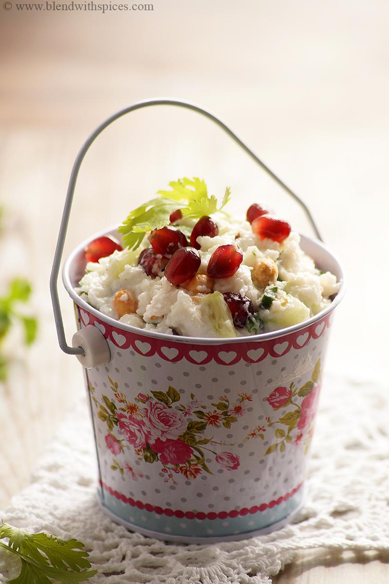 traditional maharashtrian savory dish gopalkala topped with pomegranate and cilantro.